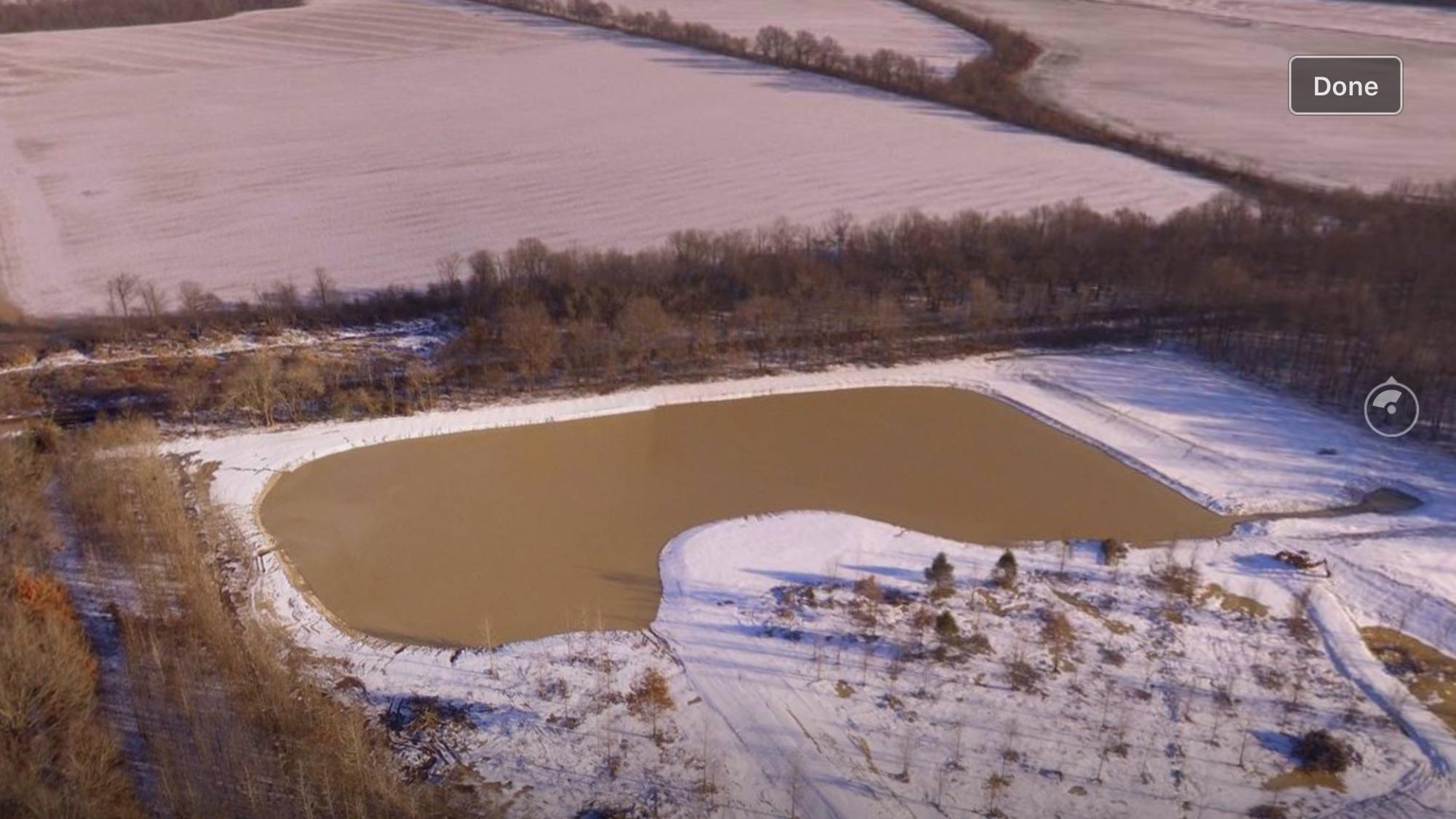 Description Full Pond After Snow