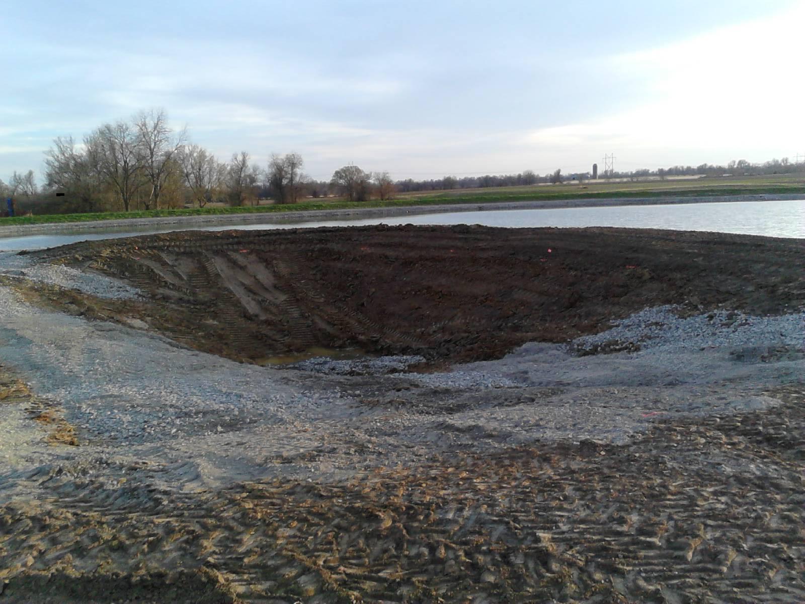 Building new forage mini pond building a dam pond boss for Pond dam design
